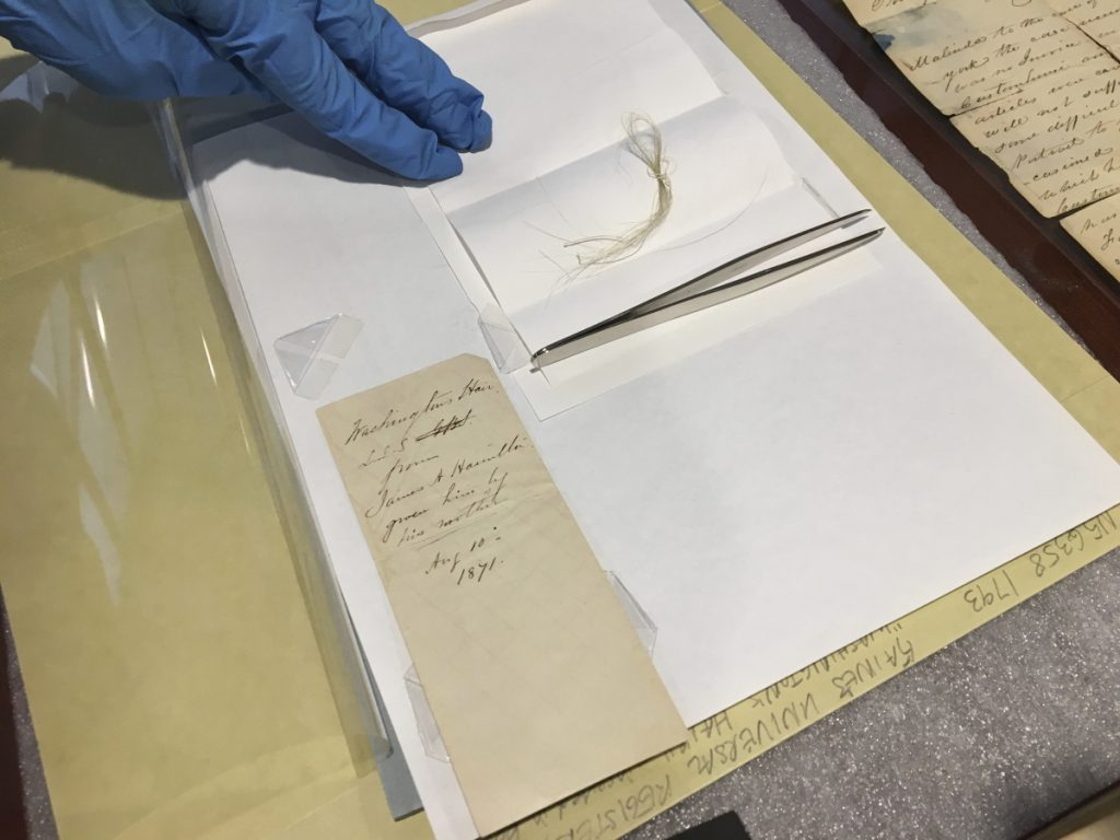 What might be a lock of George Washington's hair and the envelope that contained it are seen on a table in the Union College library in Schenectady, N.Y. John Myers, the college's catalog and metadata librarian, discovered the hair strands in a yellowed envelope he'd found in a grimy old leather-bound almanac in the school's archives.