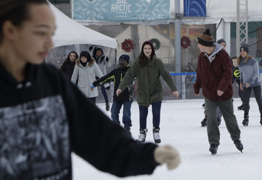 People skate at the Campus Martius ice rink in Detroit. Some cities and regions are dangling racial diversity along with positive business climates, competitive tax rates and available land in pitches to lure tech companies and high-paying jobs to town. Associated Press/Carlos Osorio