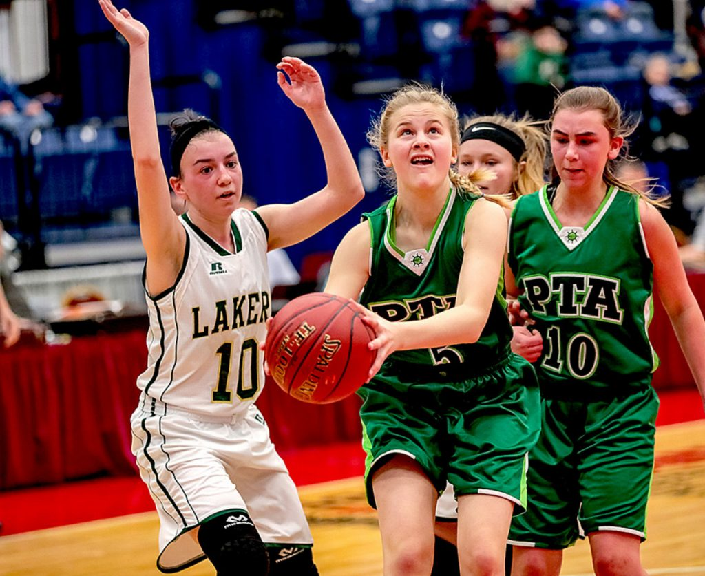Emily Schlisner of Pine Tree Academy goes to the basket in front of Rangeley's Brooke Egan during a Class D South quarterfinal Monday in Augusta. Rangeley won, 55-28.