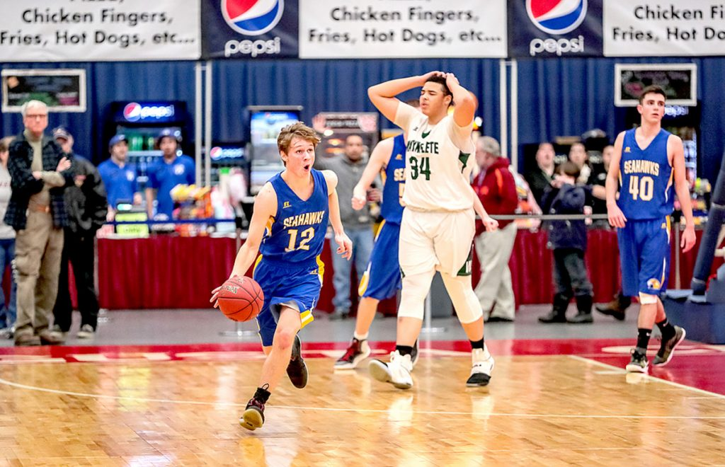 Boothbay's Kyle Ames kills off the last few seconds to secure a 65-64 victory over Waynflete in a Class C South boys' basketball quarterfinal Monday afternoon at the Augusta Civic Center.