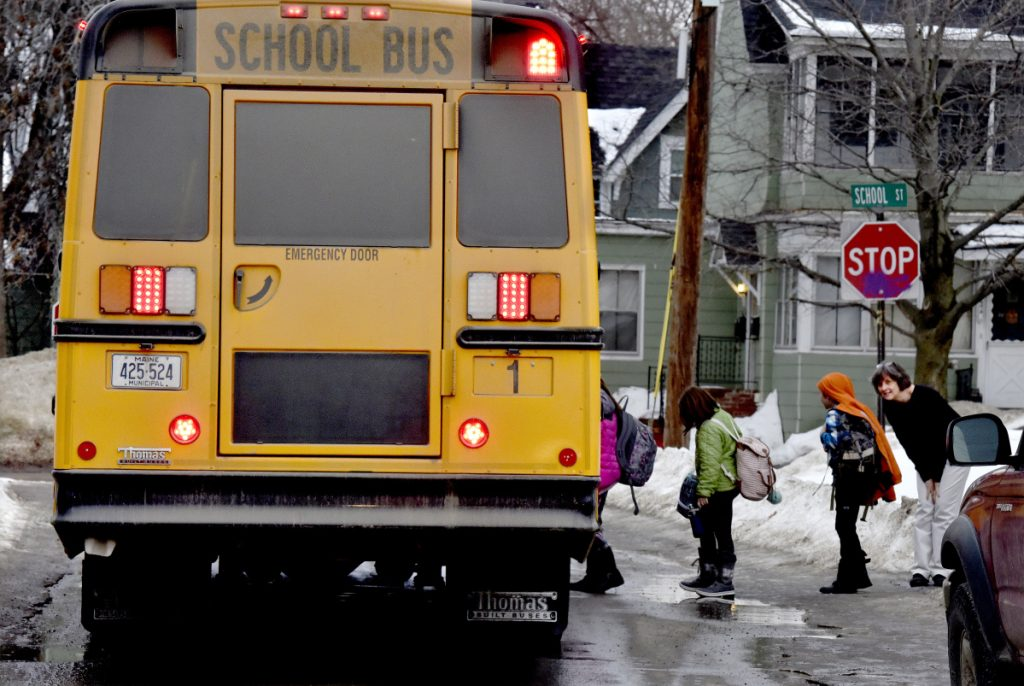 Albert S. Hall elementary students board a bus in Waterville. On Feb. 7, police received a report of a registered sex offender walking near the school and police arrested him on a probation violation charge because he was prohibited from being around the school.