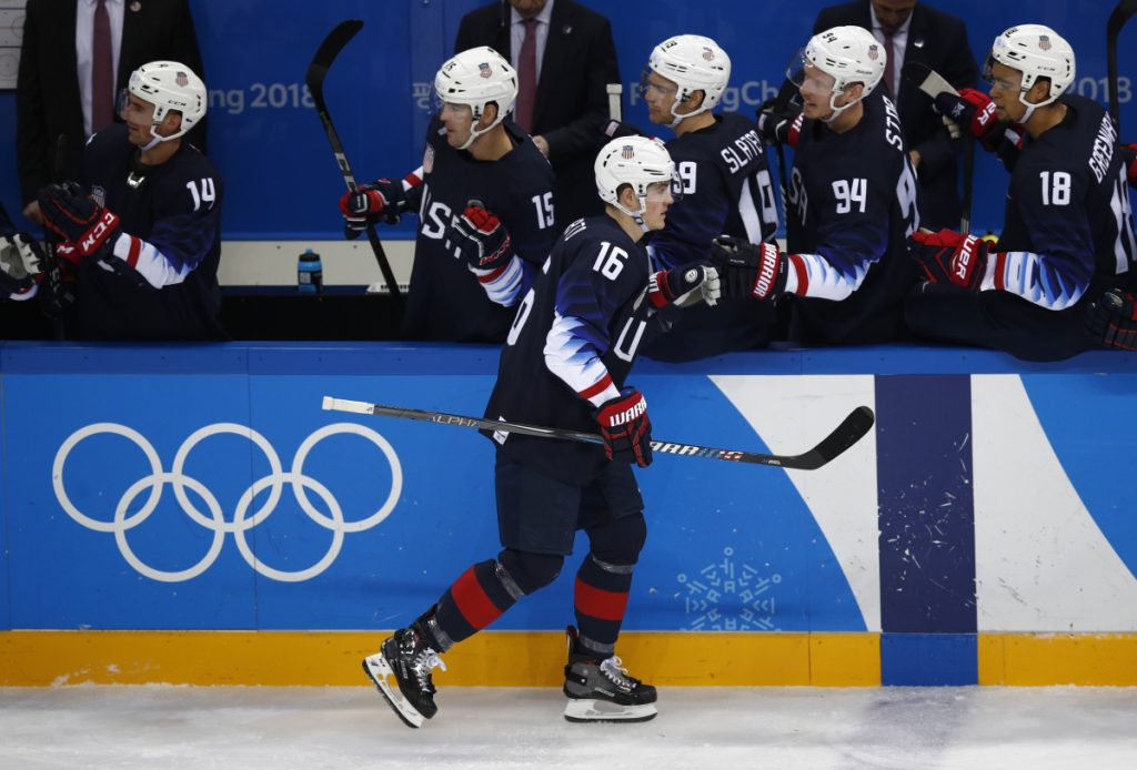 Ryan Donato high fives his teammates after scoring a goal against Slovakia.