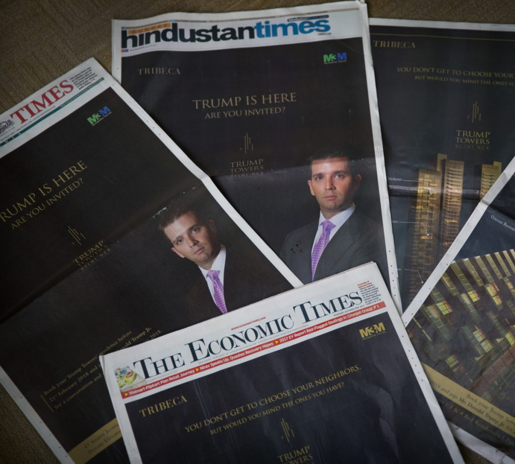 Donald Trump Jr.'s Trump Towers ads are seen in newspapers in New Delhi, India on Tuesday. Trump Jr. is in India to sell luxury real estate and will later speak at a business summit.