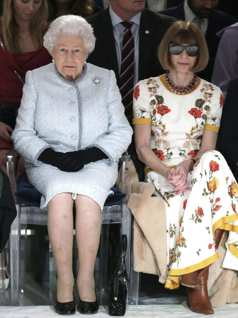 Britain's Queen Elizabeth sits next to Vogue editor Anna Wintour during London's Fashion Week on Tuesday.