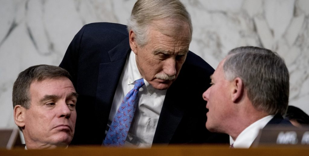 Sen. Angus King, center, at a recent Intelligence Committee hearing, says he continues to hear from Mainers who believe that reports of Russian interference in the 2016 U.S. election are nothing but fake news.