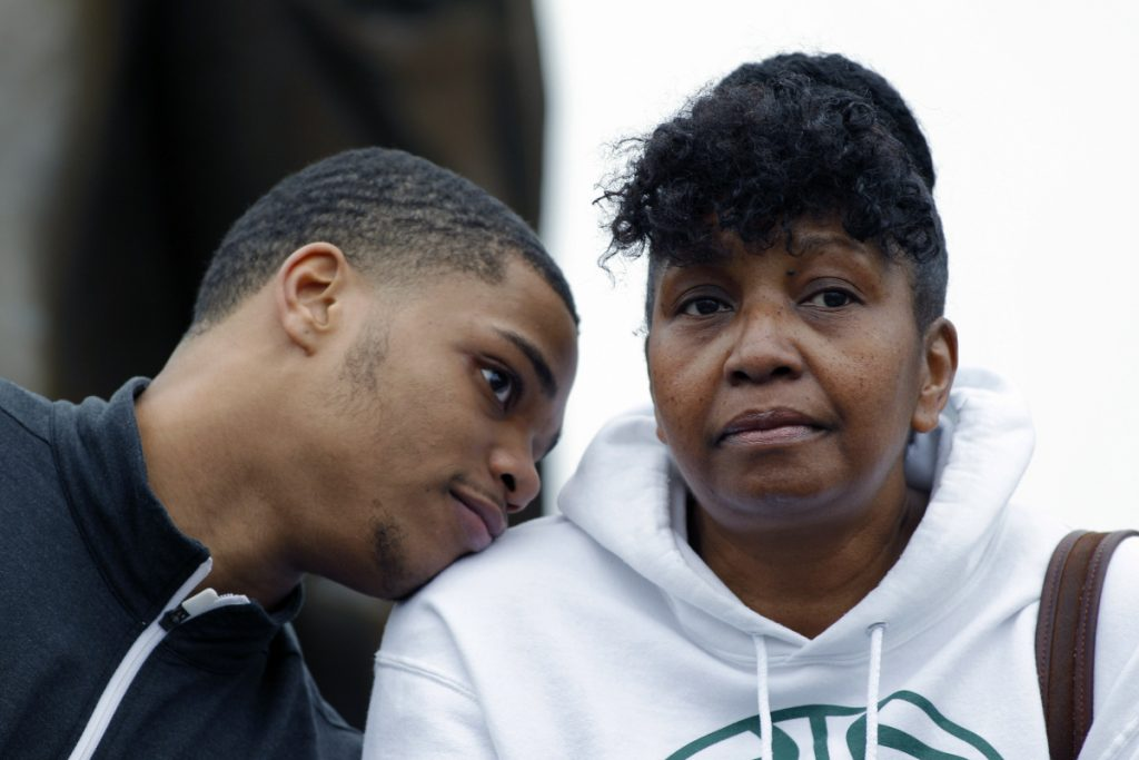 Michigan State's Miles Bridges rests his head on the shoulder of his mother, Cynthia, on April 13, 2017. Bank records and other expense reports that are part of a federal probe into college basketball list a wide range of impermissible payments from agents to at least two dozen players or their relatives, including Bridges and his mother, according to documents obtained by Yahoo Sports.