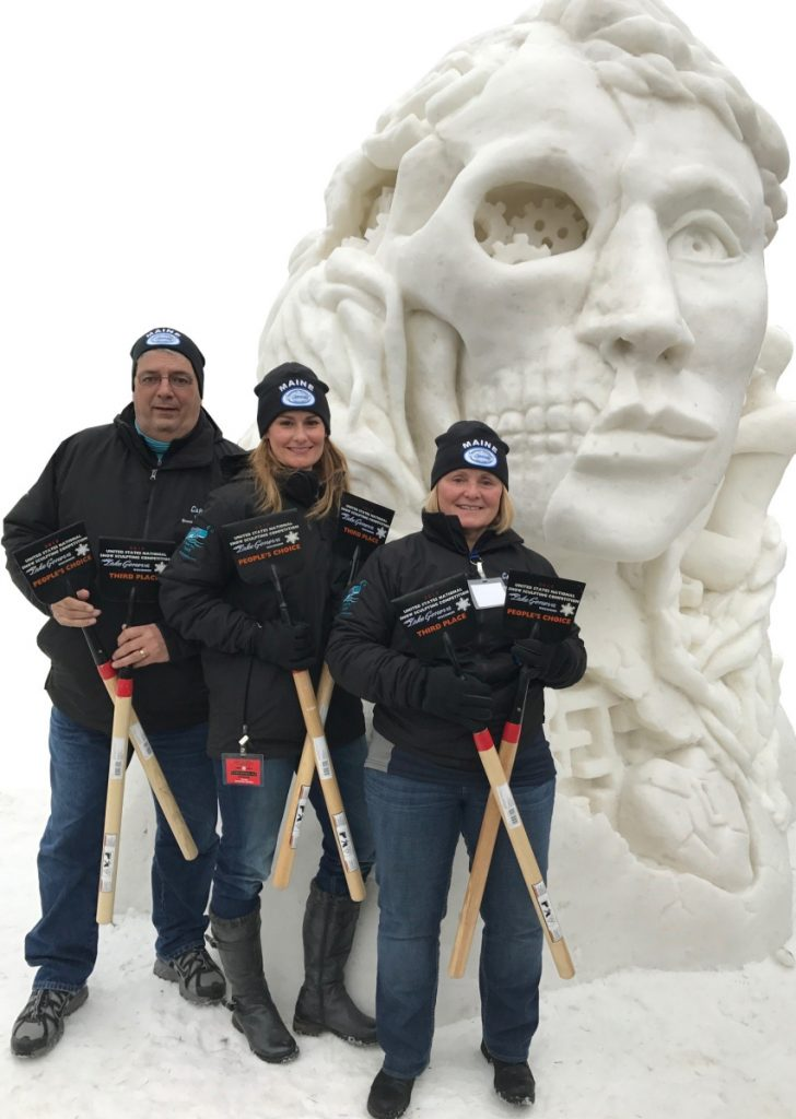 Amanda Bolduc of Skowhegan placed third at the U.S. National Snow Sculpting Championship in Lake Geneva, Wisconsin, in 2017 with her team of Cathy Thompson of Madison, on the right, and artist Paul Warren of Boston.