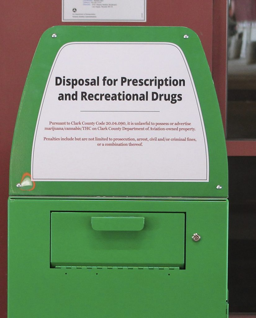 "A metal container is designed for ""Disposal for Prescription and Recreational Drugs."""