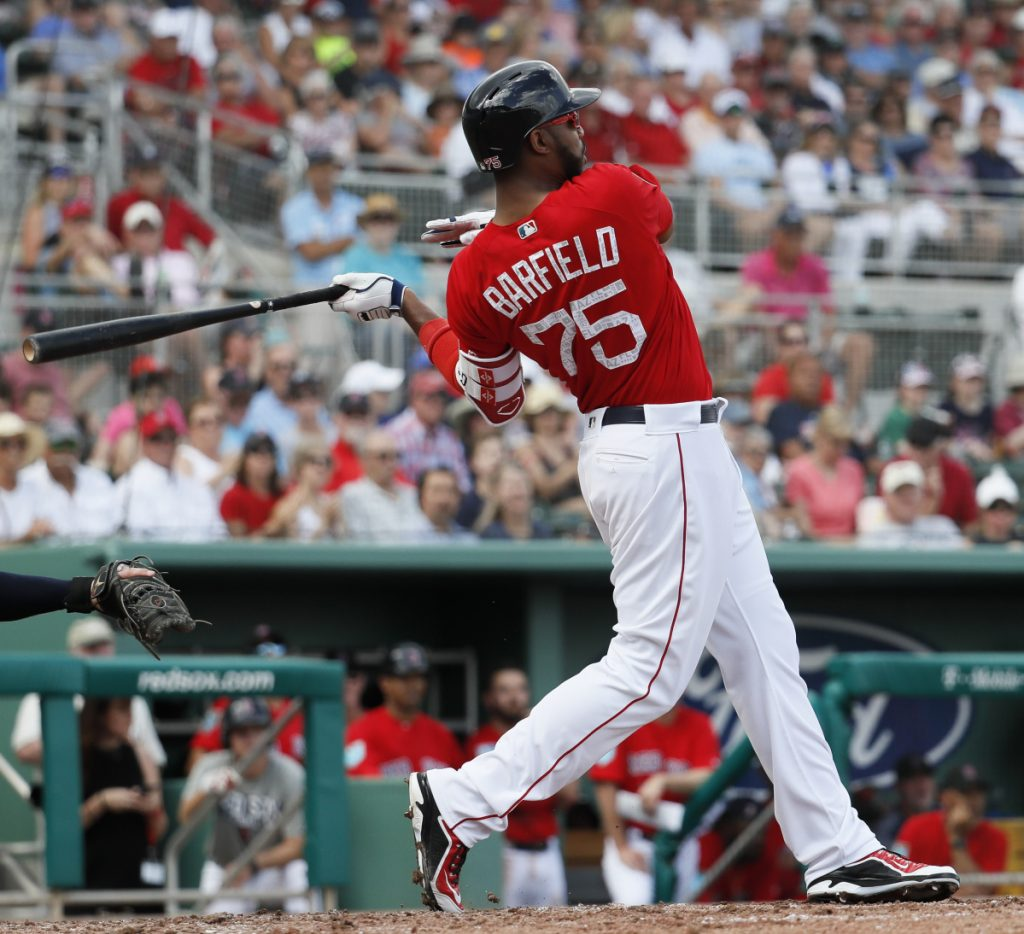 Jeremy Barfield of the Red Sox hits a two-run double in the fourth inning Friday against the Minnesota Twins, sparking Boston to a 4-3 win in its exhibition opener.