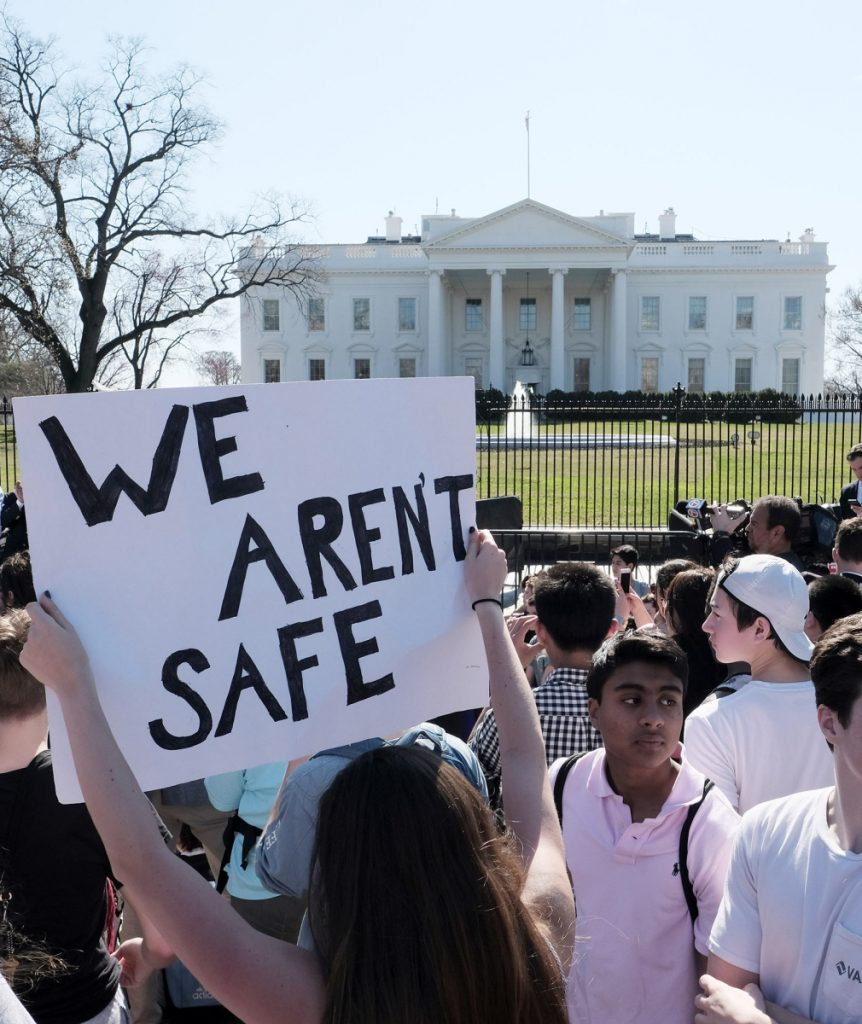 High school students gather in front of the White House on Wednesday to protest gun violence. They should seek nothing less than a ban on firearms.