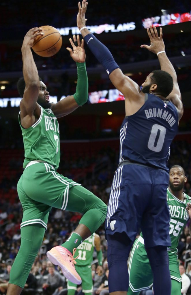 Boston Celtics guard Jaylen Brown goes to the basket against Detroit Pistons center Andre Drummond during the Celtics' 110-98 win Friday in Detroit.