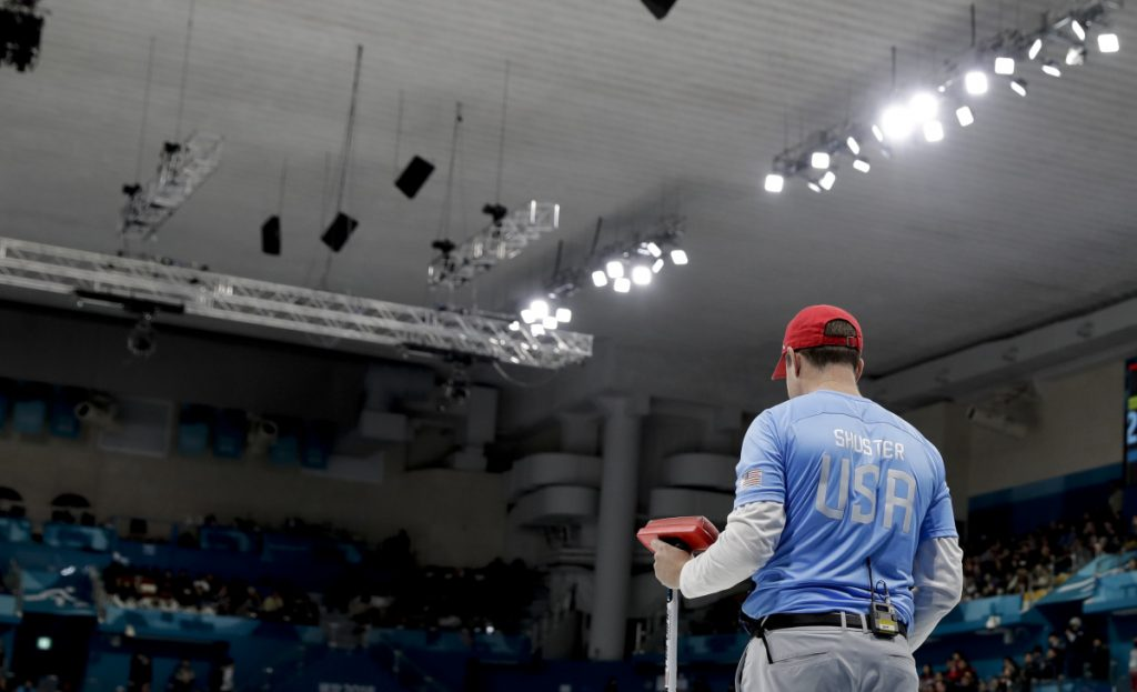 American skip John Shuster stands on the ice during the men's final curling match against Sweden.