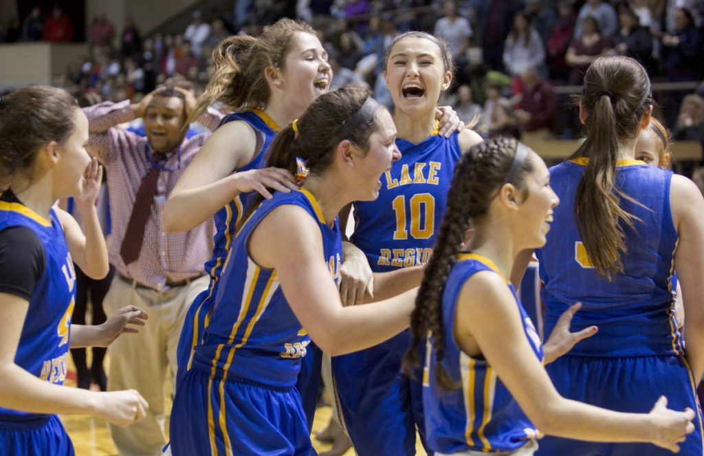 Lake Region senior Melissa Bonenfant, 10, celebrates with teammates after the Lakers' 42-34 win over Freeport in the Class B South final.