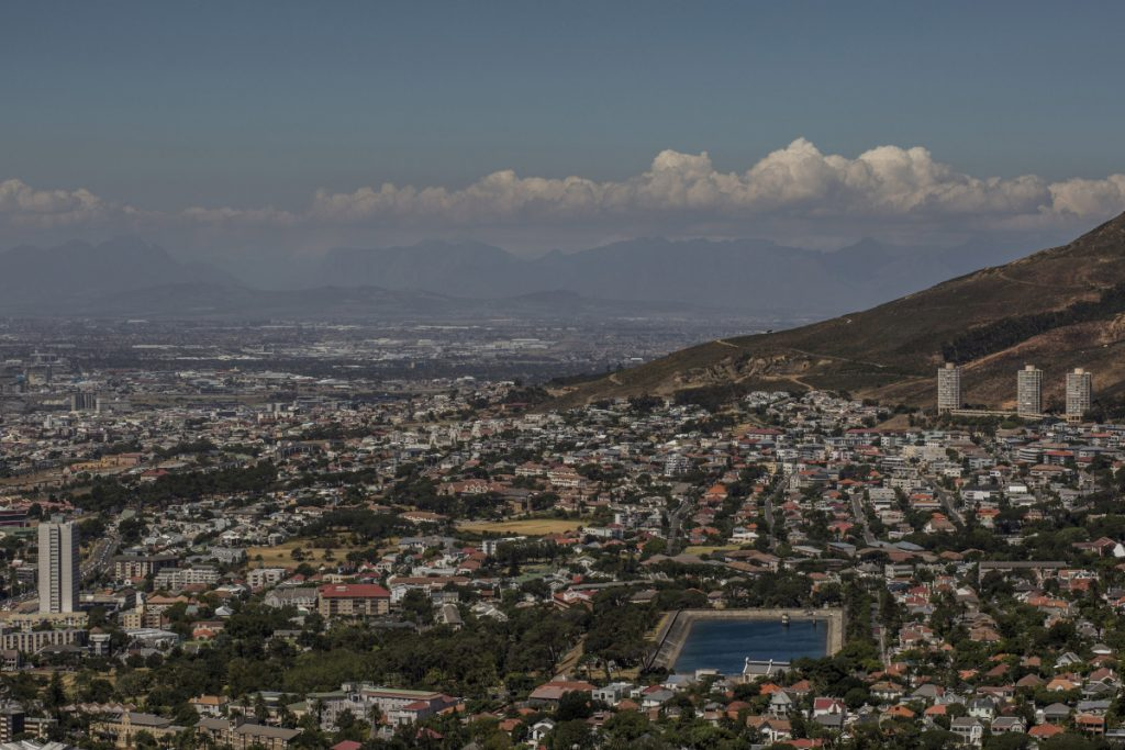 Cape Town, South Africa, a city of 434,000 stretches into the foothills of Table Mountain, with one of its depleted reservoirs seen at lower right. A drought and poor planning by the government have residents scrambling to find their own water sources.