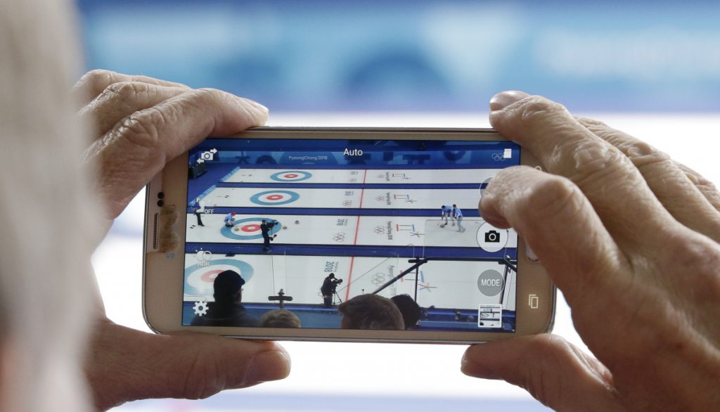 There were plenty of eyes and phones trained on curling when John Shuster's shot gave the U.S. a five-point end and a gold medal. Among those cheering Team USA were Mr. T, Aaron Rodgers and J.J. Watt.