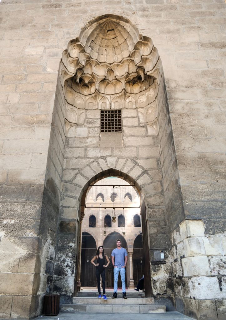 Julie Berry and Kasey Stewart stand at the entrance of an ancient citadel in Cairo, Egypt.