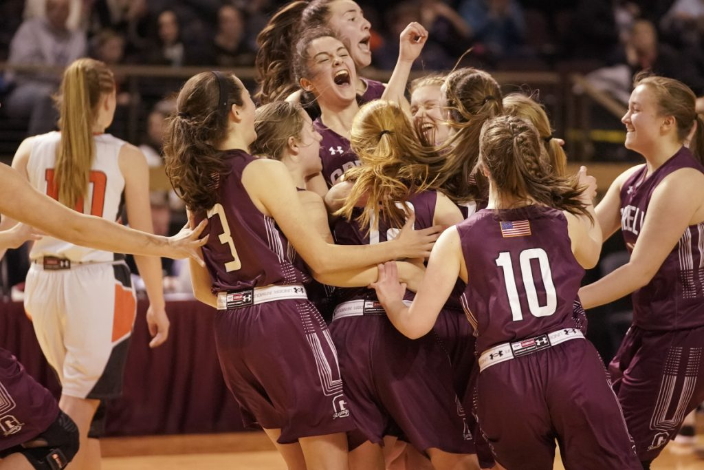 The Greely girls celebrate their victory over Brunswick in the Class A South regional final at the Cross Insurance Arena in Portland on Saturday. The Rangers will play for the state title on Thursday against Hampden Academy.