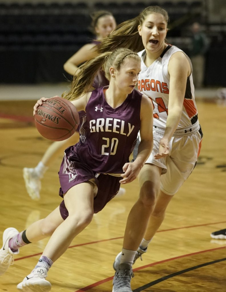 Greely's Anna DeWolfe maneuvers around Brunswick's Alexis Guptil during the Class A South girls' basketball regional final at the Cross Insurance Arena in Portland on Saturday. Greely won, 66-49, and will play for a state title on Thursday.