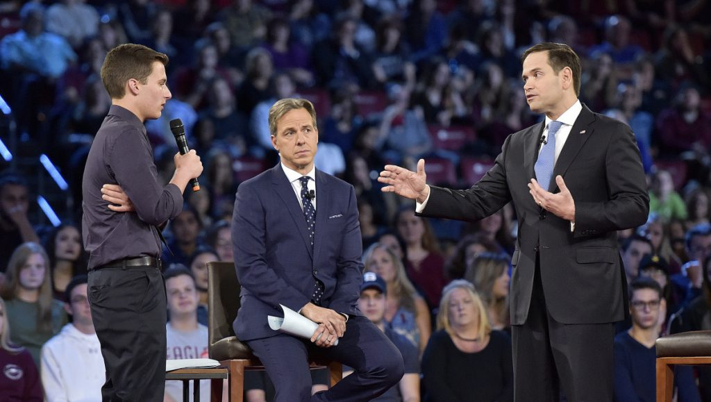 Marjory Stoneman Douglas High School student Cameron Kasky, left, asks a question to Sen. Marco Rubio during a CNN town hall meeting in Sunrise, Fla., Wednesday.