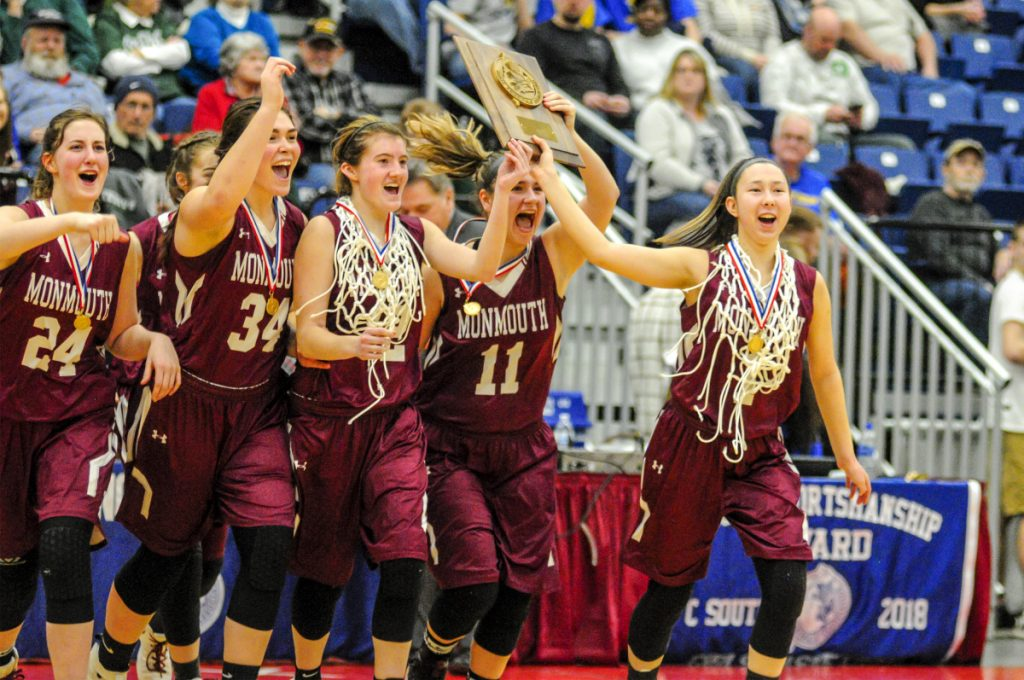 Monmouth Academy players celebrate their 51-47 win over Boothbay in the Class C South girls' basketball final Saturday night at the Augusta Civic Center.