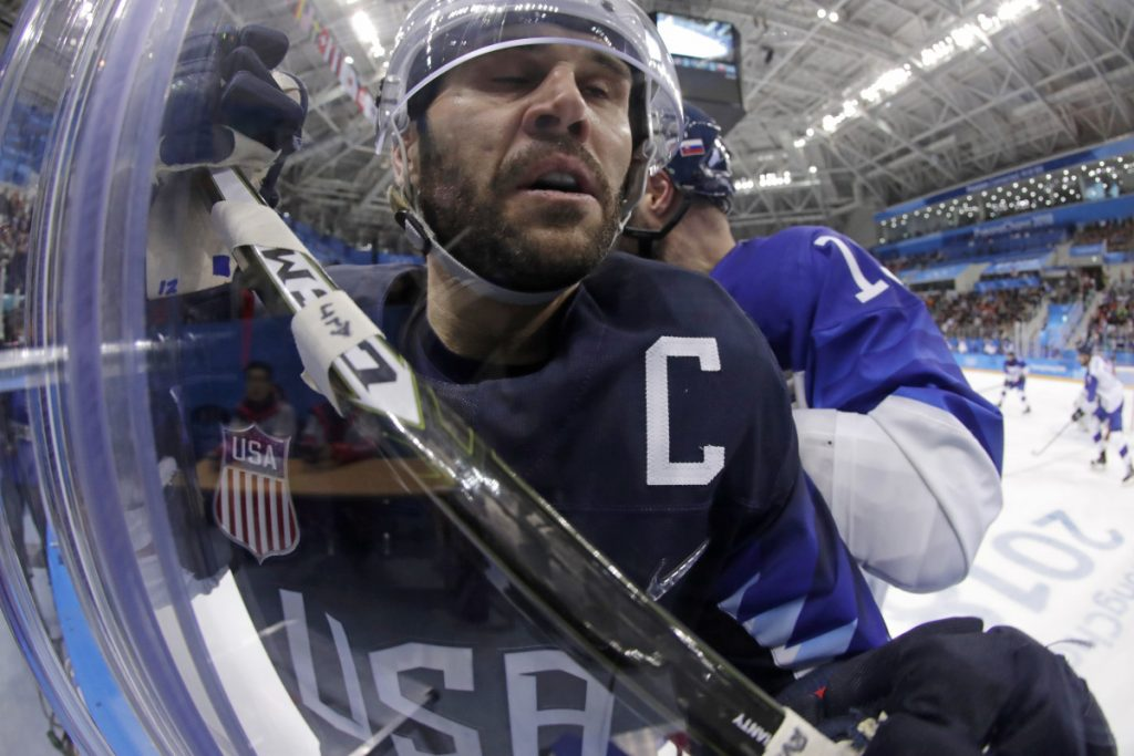Brian Gionta is checked by Tomas Starosta of Slovakia during the third period of a men's hockey game at the 2018 Winter Olympics in Gangneung, South Korea. Gionta signed a one-year deal with the Bruins on Sunday.