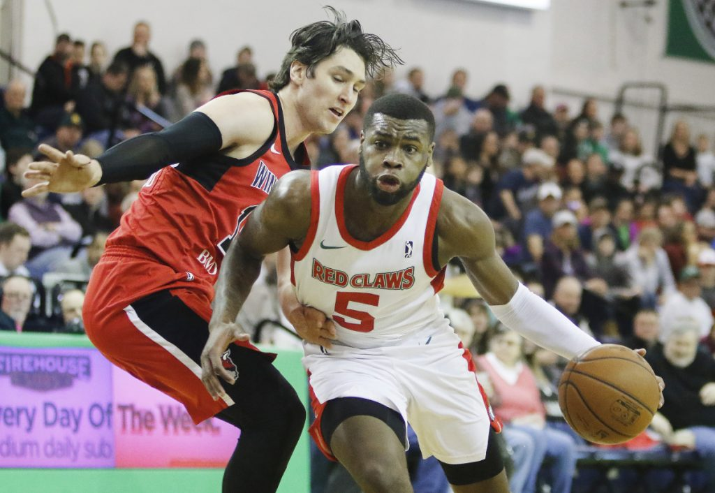 Maine's Kadeem Allen drives around Windy City's Ryan Arcidiacono in first half of the Red Claws 112-109 win Sunday at the Portland Expo.