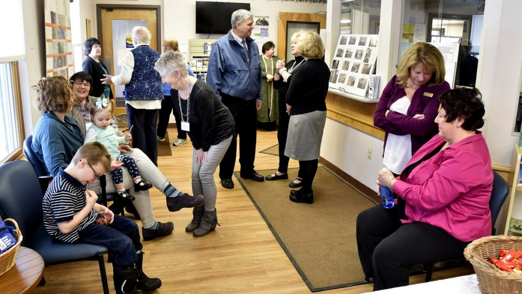 People attending the recently renovated Lovejoy Health Center in Albion socialize in a patient waiting area during an open house Sunday.