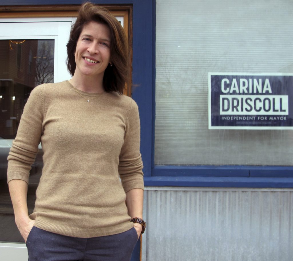 Carina Driscoll, stepdaughter of U.S. Sen. Bernie Sanders, stands outside her campaign office in Burlington, Vt. Driscoll, an independent, is among those running for mayor against incumbent Democrat Mayor Miro Weinberger.
