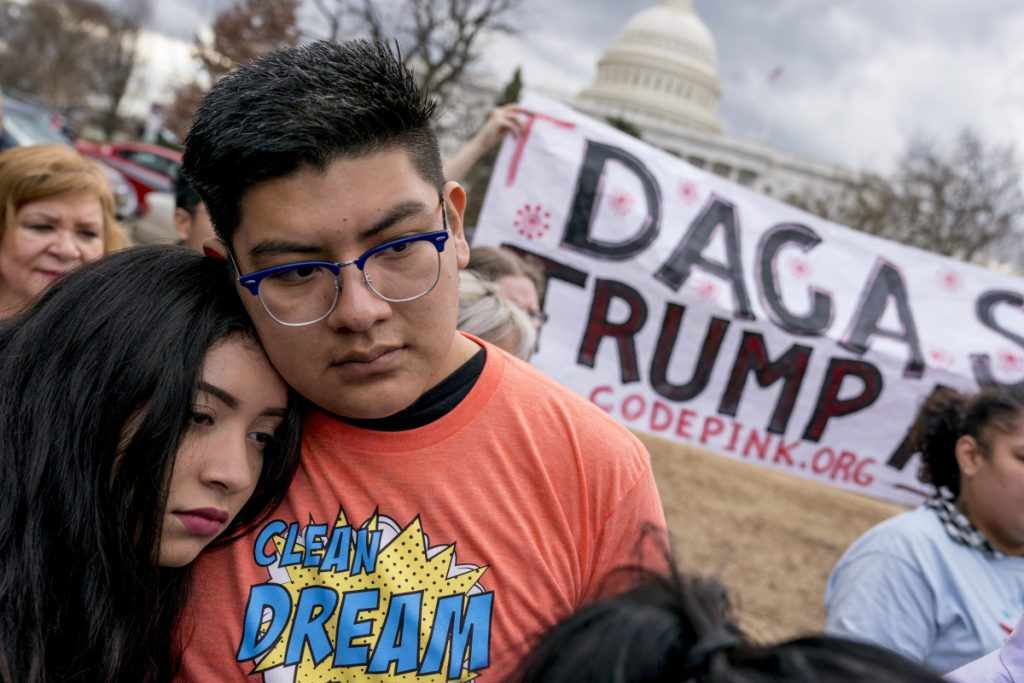 Immigration advocates hold a rally on Capitol Hill in Washington on Jan. 23. The U.S. Supreme Court on Monday denied the Trump administration's unusual request to overrule a judge who kept alive a program that shields young immigrants from deportation.