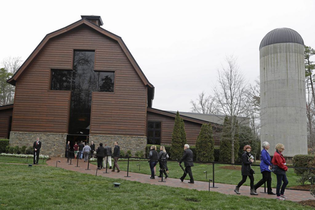 People stream through the Billy Graham Library as they come to bid farewell to Billy Graham during a public viewing in Charlotte, N.C., Monday. Former President George W. Bush and first lady Laura Bush were among them.