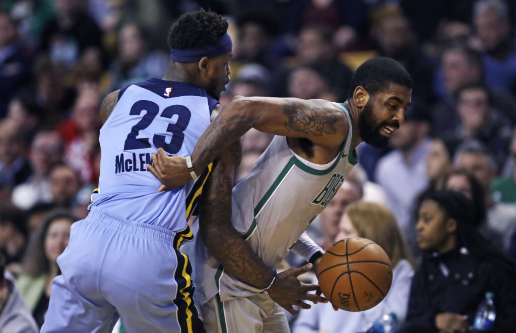 Memphis Grizzlies guard Ben McLemore tries to stop Boston Celtics guard Kyrie Irving, right, during the Celtics' 109-98 win Monday in Boston.