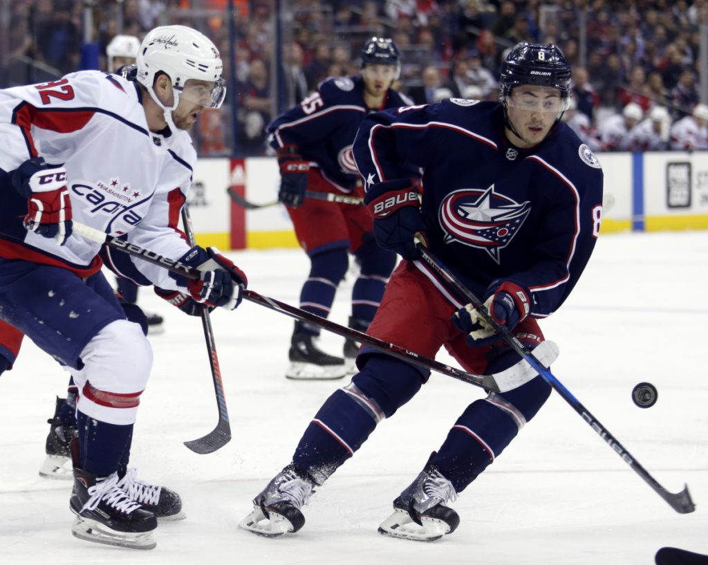 Capitals forward Evgeny Kuznetsov, left, passes the puck while Blue Jackets defenseman Zach Werenski closes in during the first period of Columbus' 5-1 win Monday in Columbus, Ohio.
