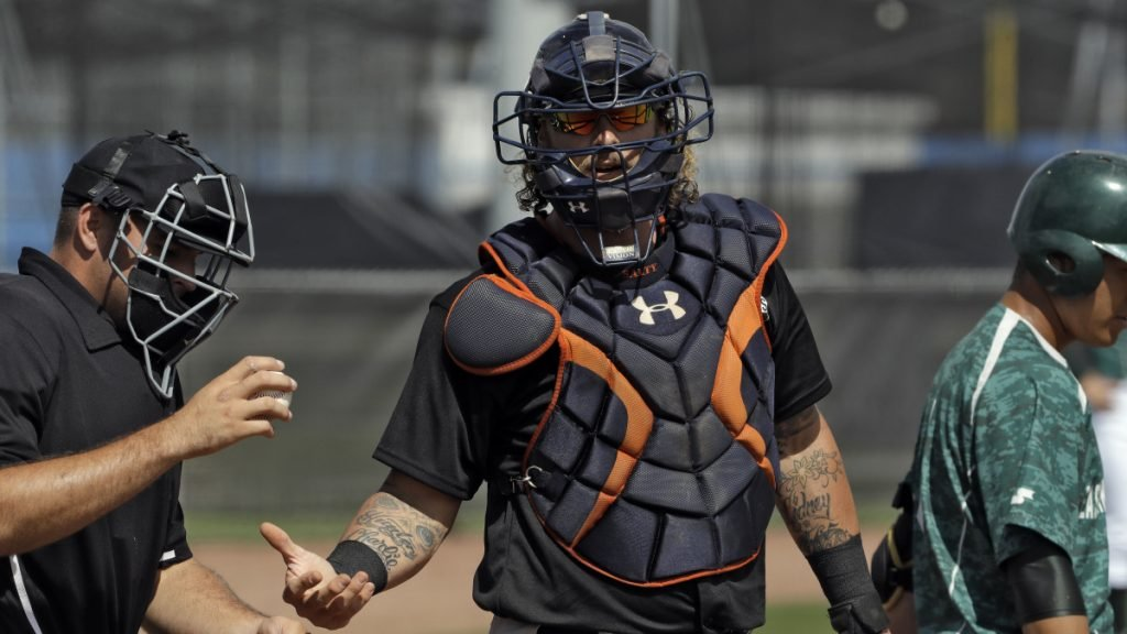Jarrod Saltalamacchia, center, is one of the players you might recognize playing in games with other free agents in Florida, hoping for a chance to impress a scout and get a job somewhere, even in the minor leagues