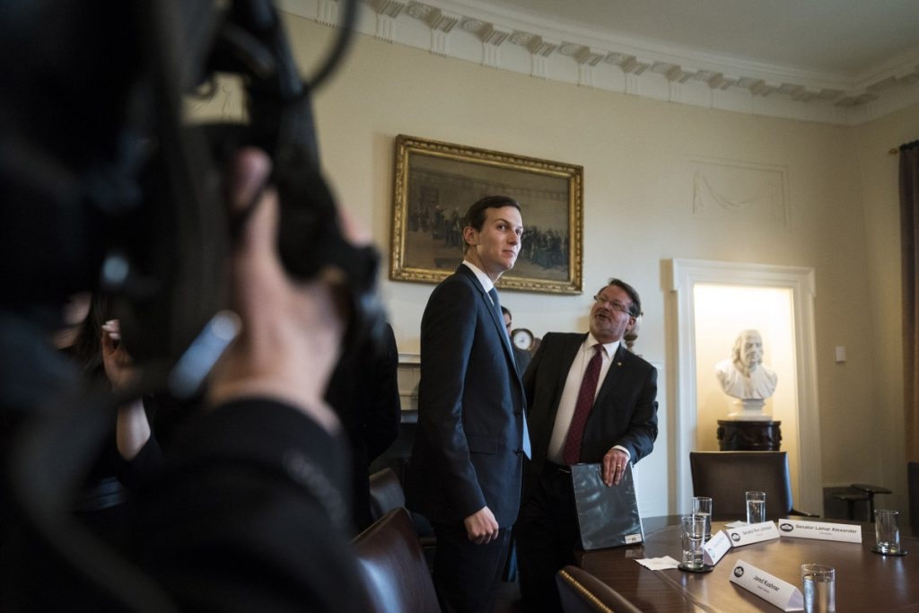 Jared Kushner stands after President Trump spoke at a meeting with lawmakers about trade policy Tuesday at the White House. Kushner's contacts with foreign government officials have raised concerns inside the White House and are a reason his interim security clearance was downgraded from the top-secret to secret.