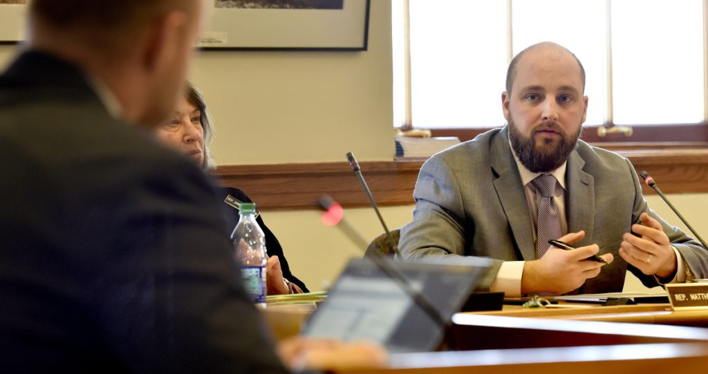 Joint Standing Committee on Taxation member Rep. Matthew Pouliot questions Nick Adolphsen, an adviser to Gov. Paul LePage, about an amendment proposed for L.D. 1629, an Act To Protect the Elderly from Tax Lien Foreclosures, on Tuesday at the State House in Augusta.
