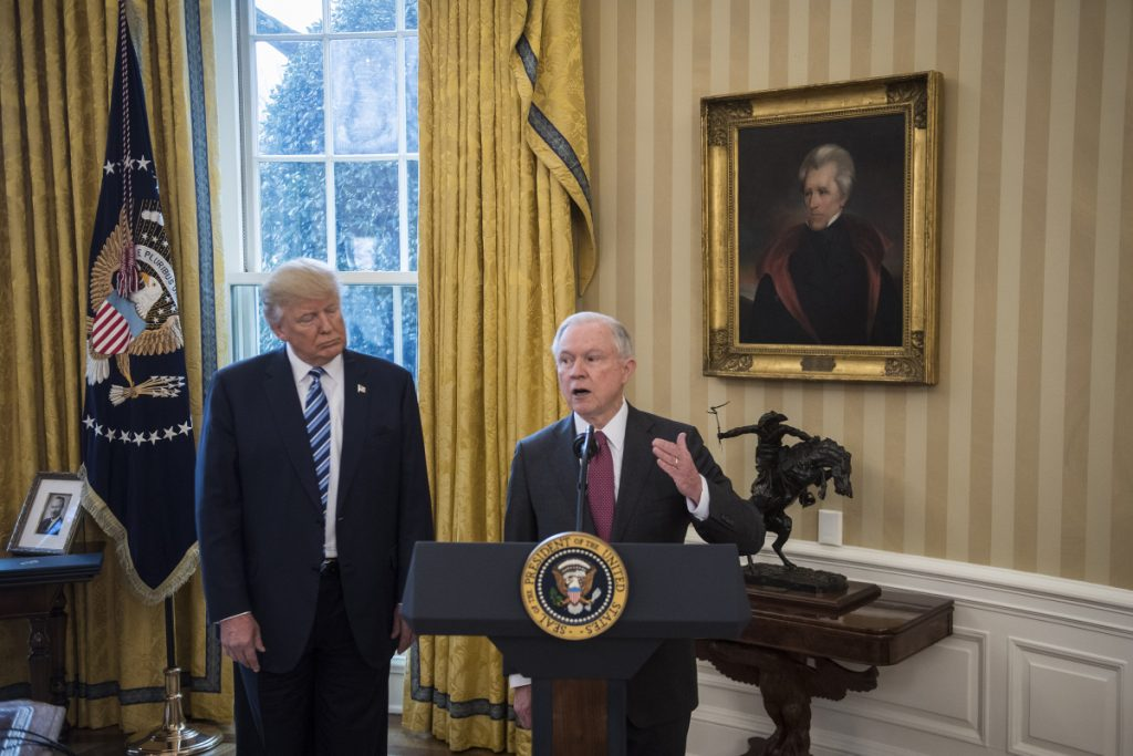 President Trump with Attorney General Jeff Sessions at the White House on Feb. 9.  Sessions insists he will not resign.