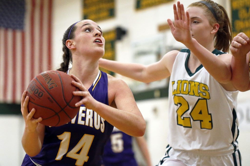 Abby Cavallaro of Cheverus looks for room under the basket as Maine Girls' Academy's Emily Weisser defends.