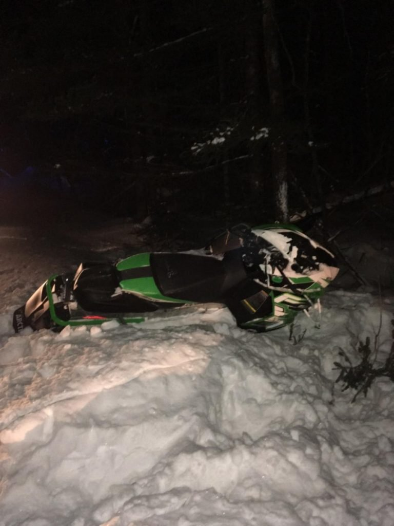 A Sangerville man died after his snowmobile crashed into a tree on Friday.