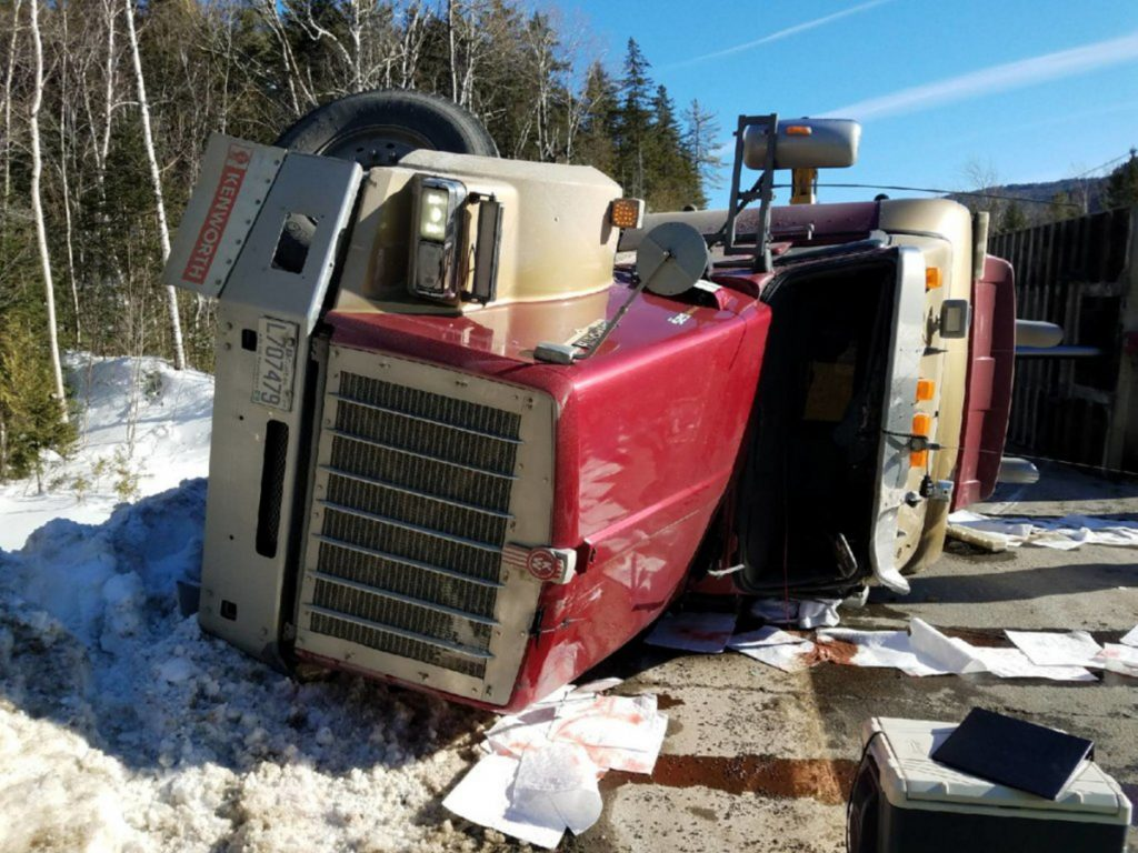A logging truck driven by Timmy Philippon, 22, of Quebec, rolled over Tuesday afternoon on Route 27 in Chain of Ponds Township, closing the road for about three hours, Trooper Jillian Monahan said.