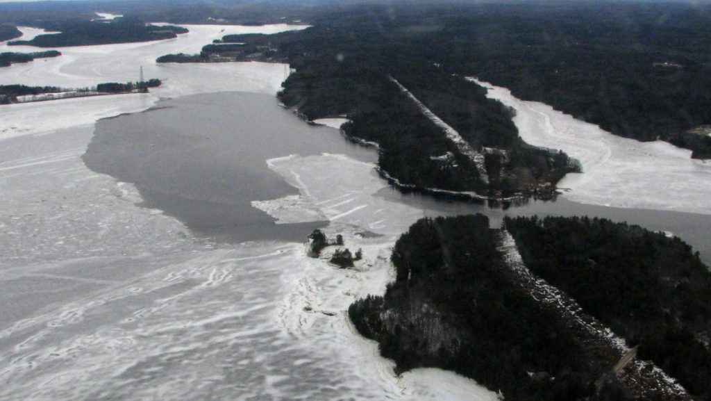Some open water is visible Thursday at Chops Point in Woolwich in a view from a Coast Guard airplane. The agency is preparing to send ice-breaking boats up the river next week.