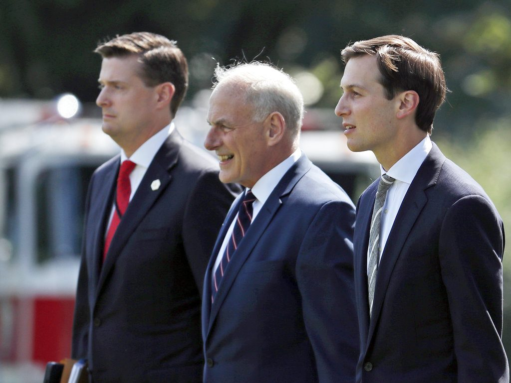 Then-White House staff secretary Rob Porter, left, White House Chief of Staff John Kelly, and White House senior adviser Jared Kushner walk to Marine One on the South Lawn of the White House on Aug. 4, 2017.