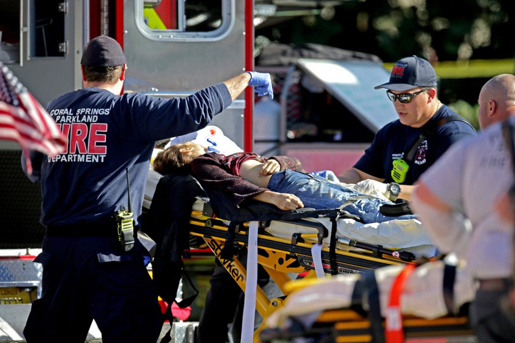 Medical personnel tend to a victim after Wednesday's shooting. Police evacuated the students and staff from the building.