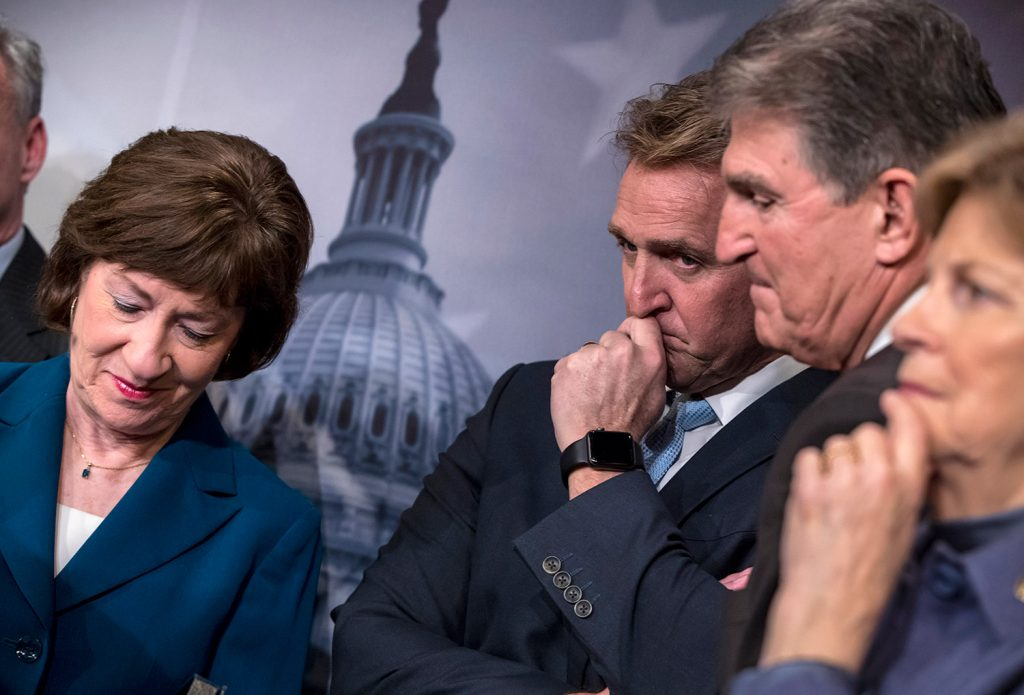 From left, Sen. Susan Collins, R-Maine, Sen. Jeff Flake, R-Ariz., Sen. Joe Manchin, D-W.Va., and Sen. Jeanne Shaheen, D-N.H., finish a news conference on the bipartisan immigration deal they reached, at the Capitol in Washington on Thursday. The plan was rejected, as was a Republican plan promoted by President Trump.