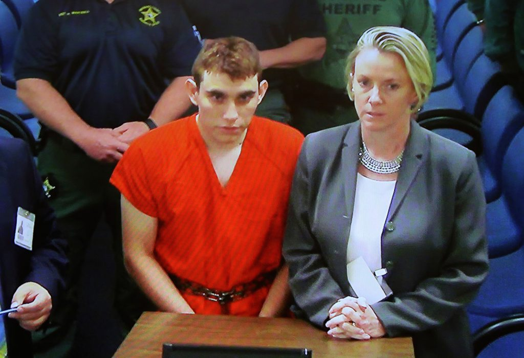 A video monitor shows school shooting suspect Nikolas Cruz making an appearance in Broward County Court on Feb. 15, 2018, in Fort Lauderdale, Florida.