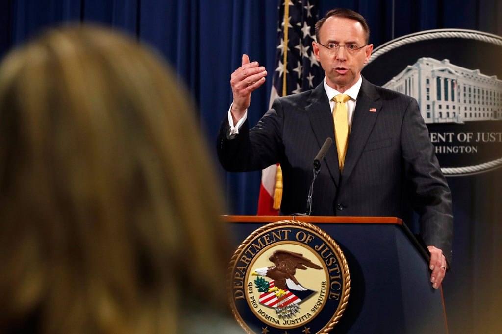 Deputy Attorney General Rod Rosenstein answers a question Friday after the office of special counsel Robert Mueller announced a grand jury has charged 13 Russian nationals and several Russian entities with an elaborate plot to interfere in the 2016 U.S. presidential election.
