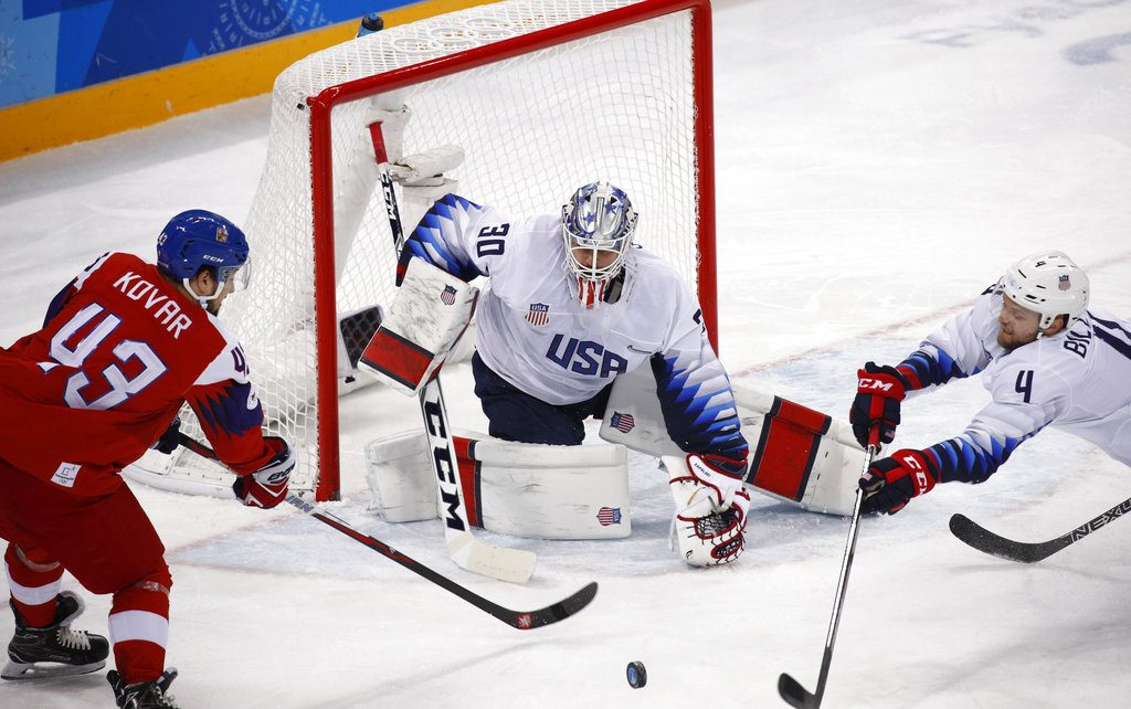 U.S. goalie Ryan Zapolski guards the goal as Jan Kovar of the Czech Republic and Chad Billins, of the U.S., battle for the puck during the first period Wednesday.