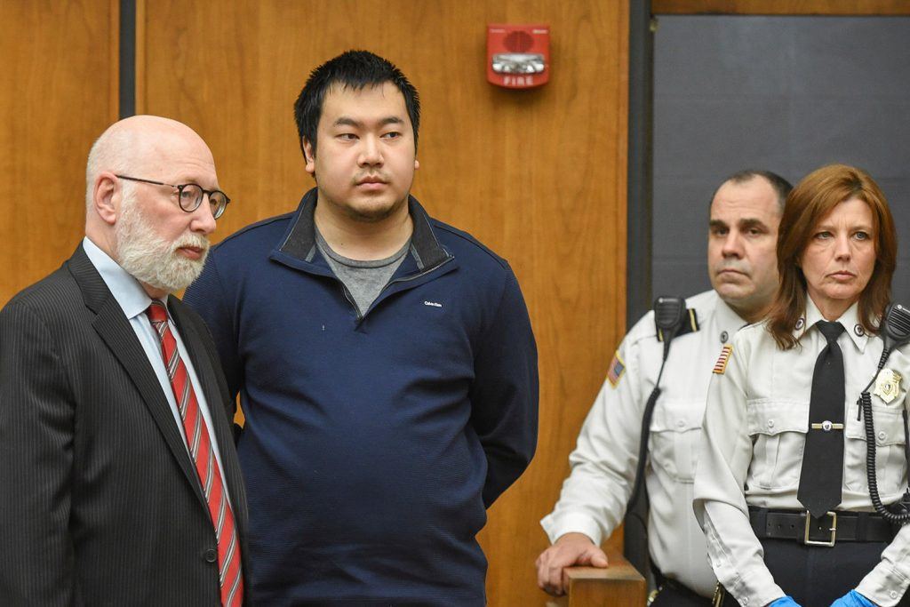 Jeffrey Yao appears with his lawyer, J.W. Carney Jr., in Woburn District Court on Feb. 26 in Woburn, Mass. Yao pleaded not guilty to murder and other charges in connection with the killing of a University of New England medical student at the Winchester Public Library.