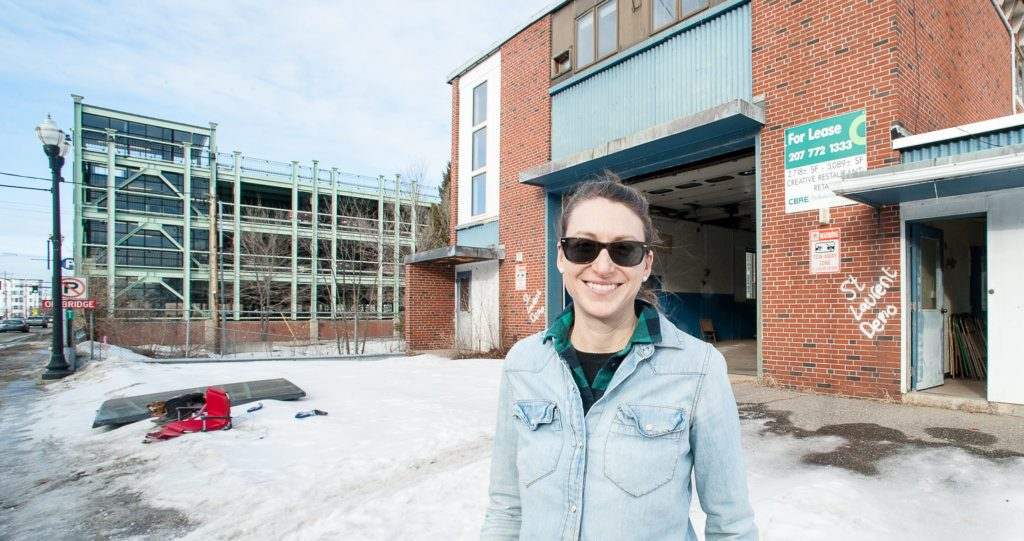 Kara Wilbur stands in front of the former Lewiston Fire Department substation on Lincoln Street on Monday afternoon. She and business partner Paul Peck hope to renovate it and attract a restaurant or brewery for the first floor.