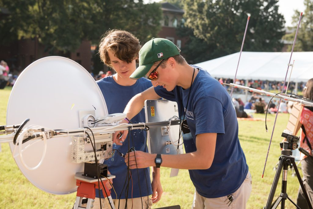 Two engineering students verify that telemetry is being received at the primary ground station. They were among those from the UMaine community who traveled to Clemson, S.C., in August to participate in the first-ever NASA Great American Eclipse Project.