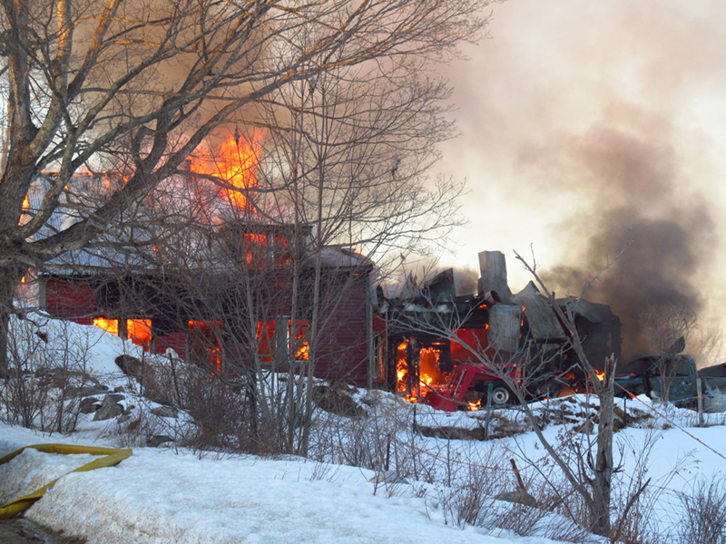 The wood-framed farmhouse of Hartford historian Lorraine Parsons was destroyed by flames Wednesday afternoon.